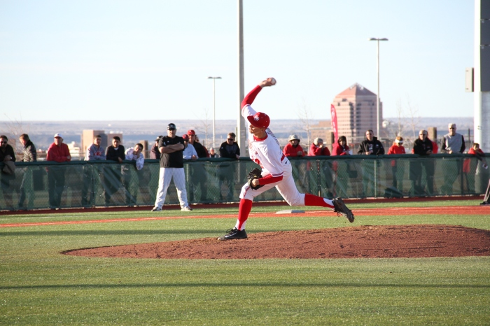 UNM pitcher Drew Bridges throws a pitch during the Lobos 12-0 win over Northern Illinois on Feb. 21. The Lobos were unable to host an NCAA Regional last year because Lobo Field didn't meet the NCAA's standards. (Photo by Thomas Romero-Salas)