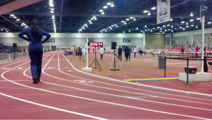 An athlete warms up for a collegiate meet on the Albuquerque Convention Center's indoor during this past indoor track and field season.